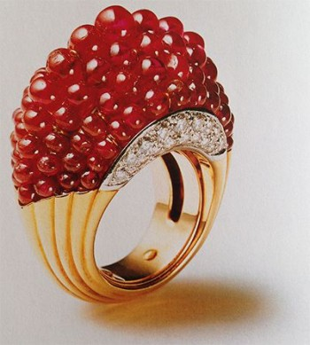 Gold and Ruby Cocktail ring by Cartier 1965. Extravagant example of lustrous graded ruby gems, complimented by the richness of the gold and the glamour of the diamonds. An amazing showpiece.